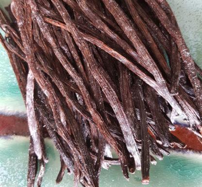 Cristaux de vanilline sur gousses de vanille